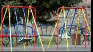 Stock Video Footage of Empty swings in a playground