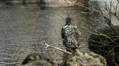 Fisherman fishing near the hydroelectric power station dam. Stock Footage