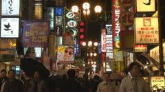 People visiting Dotonbori street by night, Osaka, Japan Stock Footage