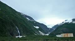 Whittier Alaska waterfall oil tanks on mountain P HD 8107 Stock Footage