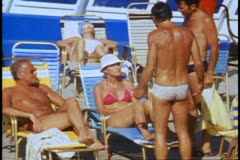 QE2 deck, 1982 World Cruise, crowd on deck in swimsuits, medium shot Stock Footage