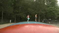 Kids jumping on large trampoline. Stock Footage