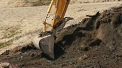 Excavator Scoops Dirt into Dump Truck close Stock Footage