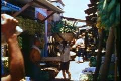 Salvador, market, medium wide, black man carries on head into market Stock Footage