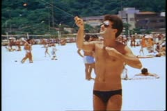 Rio de Janeiro 1982, Copacabana beach, close up, young man fling kite Stock Footage