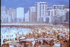 Rio de Janeiro 1982, Copacabana beach, crowded, hotels in background, medium Stock Footage
