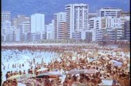 Stock Video Footage of Rio de Janeiro 1982, Copacabana beach, crowded, hotels in background, medium