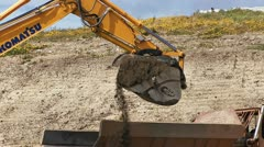 Excavator Dumping Dirt from Bucket Shovel close Stock Footage