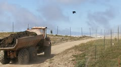 Heavy Dump Truck Hauling Fill Dirt Uphill Stock Footage