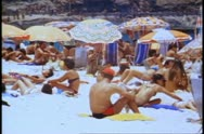 Stock Video Footage of Rio de Janeiro 1982, Copacabana beach, medium shot crowd