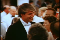 Captain's cocktail party, 1982 QE2 World Cruise, formal, young man in tuxedo - stock footage