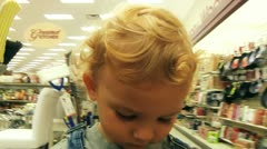 Boy in shoping cart Stock Footage