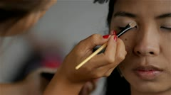Makeup Artist Applying Makeup on a Female Model Stock Footage