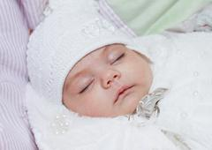 Stock Photo of Portrait of a sleeping newborn baby girl