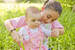 Help to walking a baby girl Stock Photos