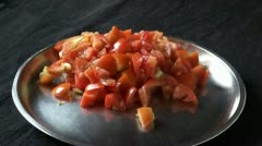 Ready cut tomatoes for cooking - stock footage