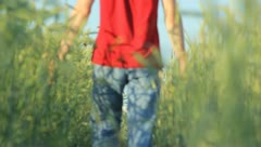 The man walks in the cereal field path Stock Footage