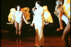 QE2 showroom, tap dancer, 1982 QE2 World Cruise, tapping feet Stock Footage
