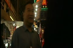 Busy marketplace at night in Hong Kong 3 by DJM Stock Footage