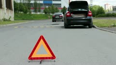 Warning sign on road and car emergency lights Stock Footage