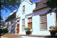 Stellenbosch, South Africa, Dutch style gabbled building, medium shot, winery Stock Footage