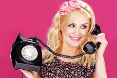 Woman talking on old telephone Stock Photos