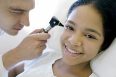 Ear examination Stock Photos
