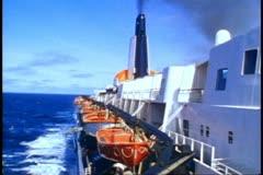 QE2, 1982 World Cruise, stack, lifeboats, sea churning - stock footage