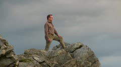 Walker admiring the view from the Stiperstones, Shropshire Stock Footage