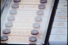"QE2, 1982 World Cruise, bridge, close up button panel, tilt up, ""Full Speed - stock footage"