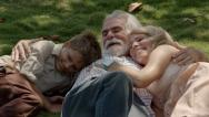 Happy grandparents with child having fun in city park Stock Footage