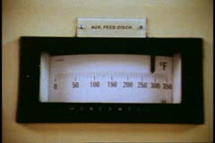 QE2, 1982 World Cruise, Engine Room, close up gauge dial, round - stock footage