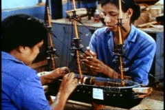 Mauritius, Model boat factory in Curpipe, two girls sewing mast on model Stock Footage