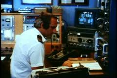 QE2, 1982 World Cruise, radio room, operator, medium wide shot - stock footage