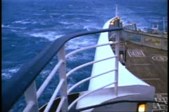 The stern of the QE2 moving in gray waters Stock Footage