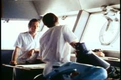 QE2, 1982 World Cruise, bridge, close, zoom wide, helmsman - stock footage