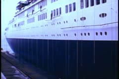 Painting the QE2 in the Hong Kong harbor, 1982 wide shot Stock Footage