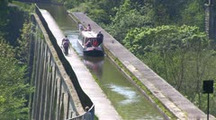 Canal boat on Llangollen canal at Chirk aqueduct, Wales. Stock Footage