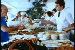 QE2 1982 World Cruise, QE2 buffet, wide shot, lots of people and food Stock Footage
