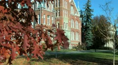 College brick building in autumn Stock Footage