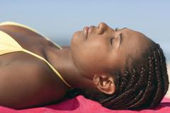 Woman sunbathing Stock Photos
