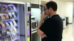 Man picking item out of vending machine Stock Footage