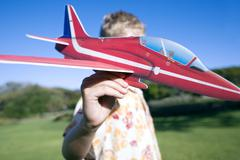 boy playing with a model aeroplane - stock photo