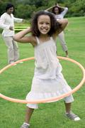 Girl playing with a hula hoop Stock Photos