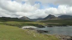 Peaks and coast near Harris Isle of Rum Scotland Stock Footage