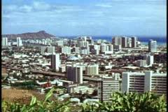Honolulu, wide shot, establishing, Diamond Head, hotels, city below Stock Footage