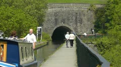 Canal boat on Llangollen canal at Chirk aqueduct Stock Footage