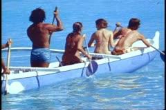 Waikiki, medium shot six people rowing dugout canoe out to sea Stock Footage