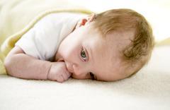 Stock Photo of baby girl sucking her thumb
