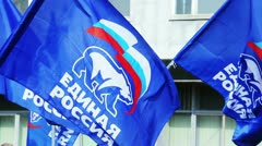Flags of United Russia political party during the May Day Trade Union Stock Footage